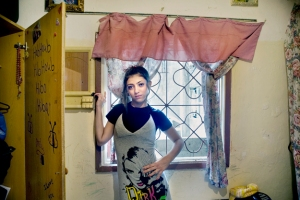 """Hiba, Shatila Refugee Camp, Beirut 2010"" from ""A Girl and Her Room"" by Rania Matar"